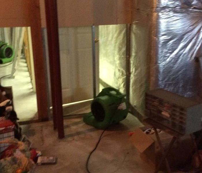 Room with flood cuts and green air movers.