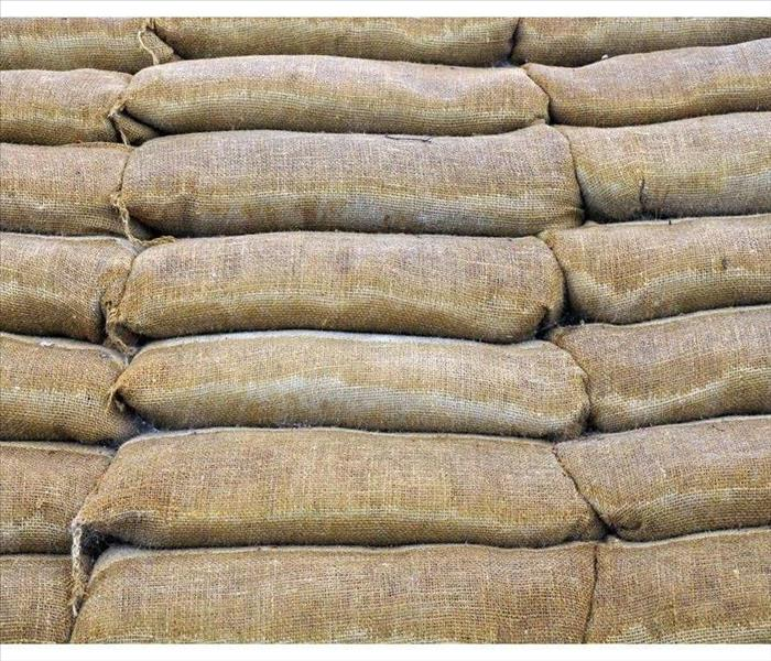 Wall barrier of sand bags