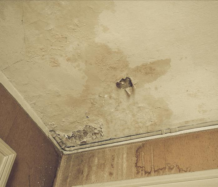 Ceiling damaged by water, discolored ceiling