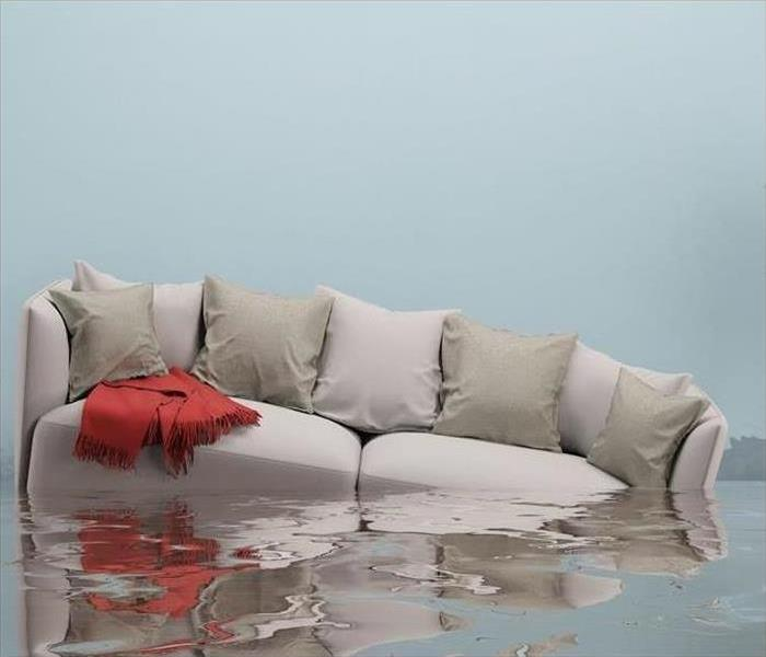 Furniture floating in a flooded house (3D Rendering)