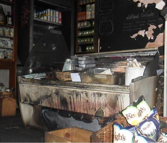 Business has been totally burned, shelves with canned food, freezer, everything is burned