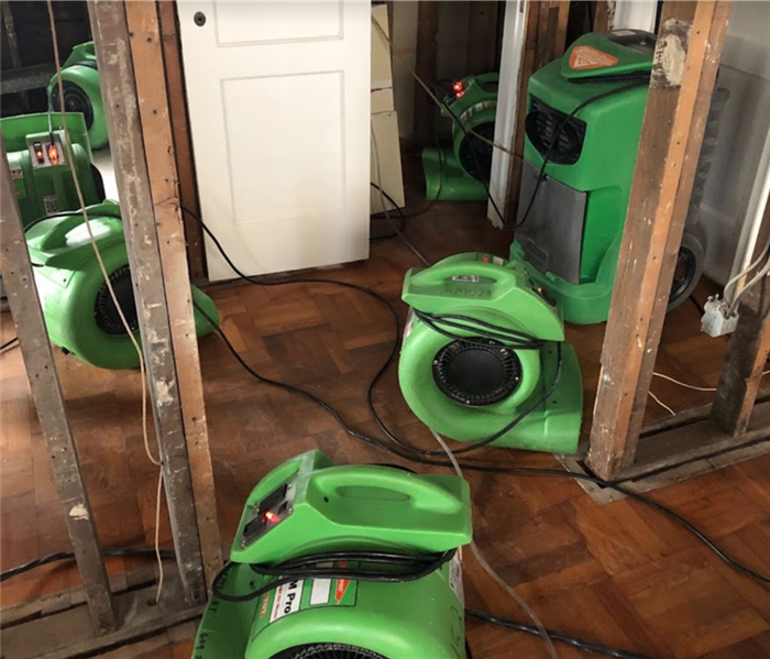 Air movers placed in area affected by water